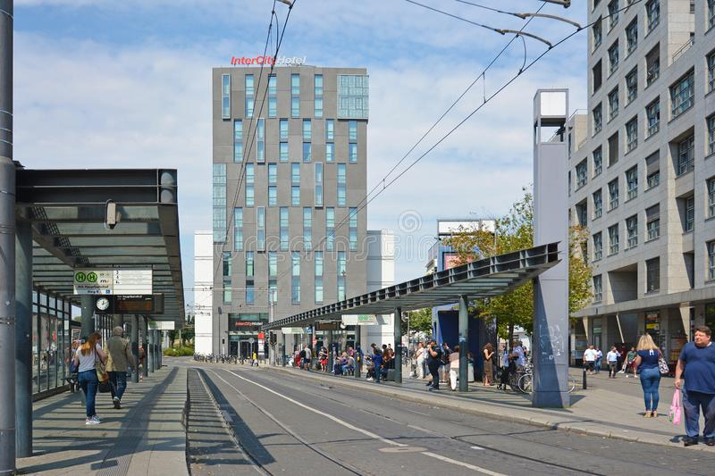 People waiting at big bus and cable car station in front of centrail train station royalty free stock photos