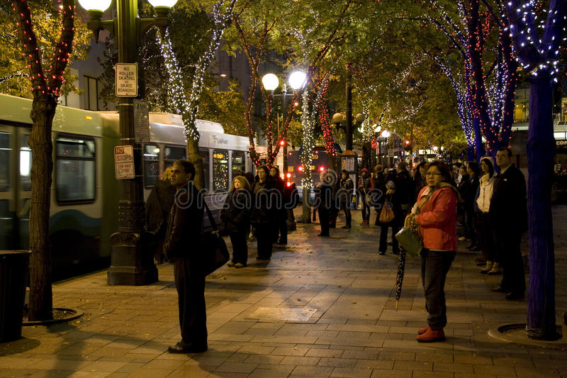 People waiting for bus. People were anxiously waiting for bus after work at downtown Seattle in the cold holiday evening royalty free stock photo