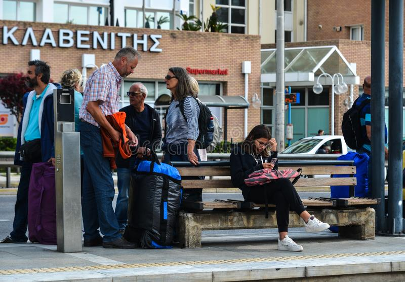 People waiting for bus in Athens, Greece. Athens, Greece - Oct 13, 2018. People waiting for bus in Athens, Greece. Athens is a global city and one of the biggest royalty free stock image