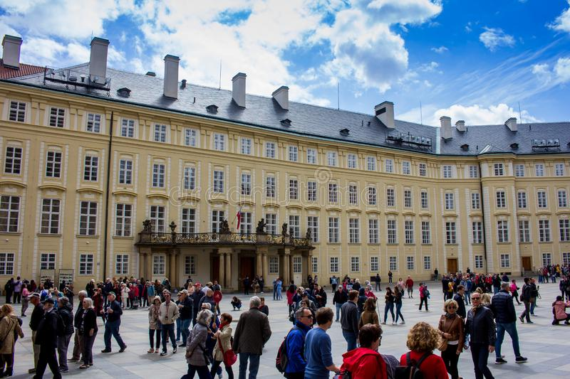 People waiting for the changing of the guards at Prague Castle stock images