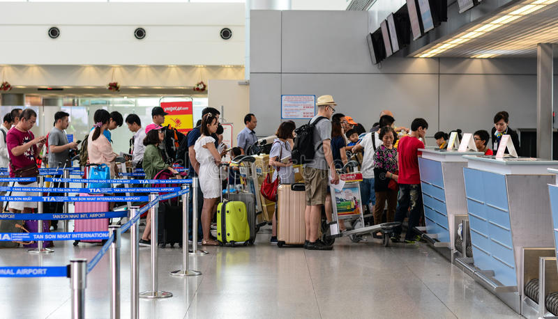 People waiting for check-in at the Cat Bi airport in Hai Phong, Vietnam.  stock image