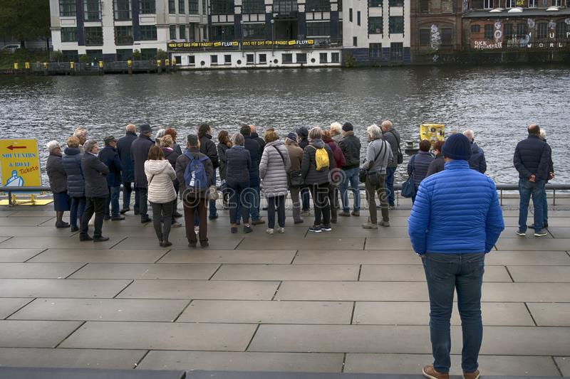People waiting close to Spree in Berlin. stock image