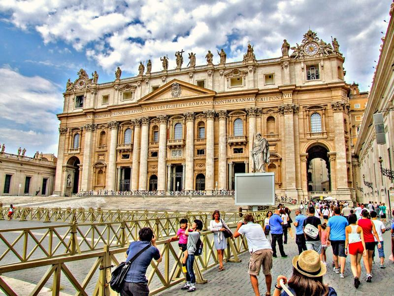 People taking photos at the Saint Peter`s Basilica in Vatican. HDR. People are waiting for the entrance to the Basilca. People are taking photos. Saint Peter`s royalty free stock photography