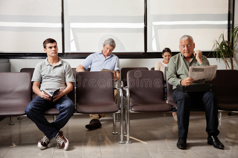 People Waiting In Hospital Lobby stock images