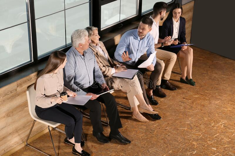 People waiting for job interview in office hall royalty free stock image