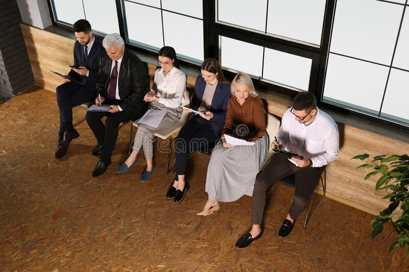 People waiting for job interview in office hall royalty free stock images