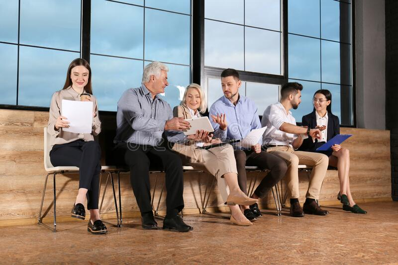 People waiting for job interview in hall royalty free stock image