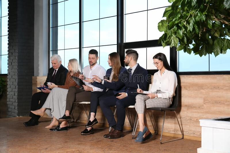 People waiting for job interview in hall royalty free stock photography