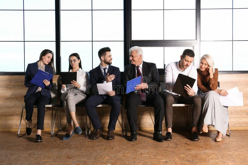 People waiting for job interview in hall stock photos