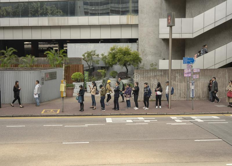 People waiting in line for the bus stock images
