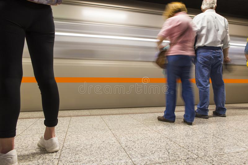 People waiting for the subway train to stop on Omonia Square stock photography