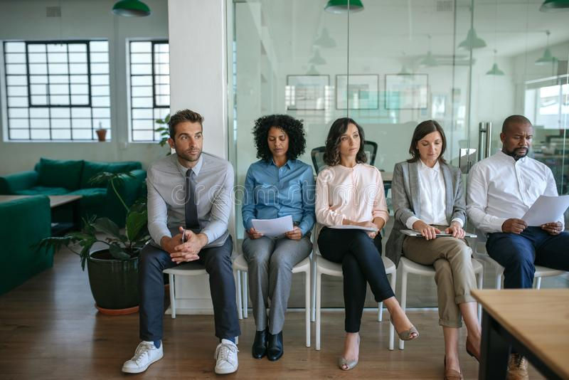 People waiting for their job interviews in an office stock photography