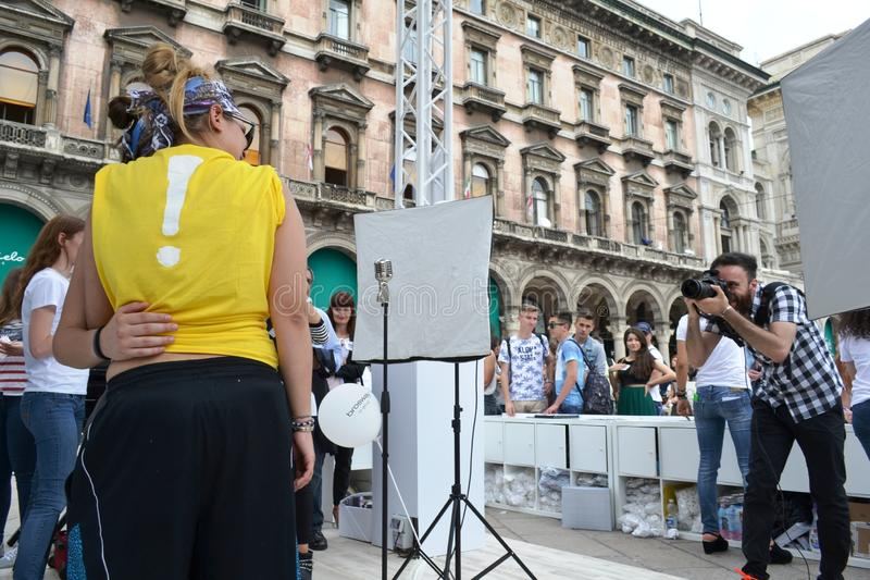 People waiting to be photographed for free on outdoors photo set `Brosway` in Milan Duomo square. Milan, Italy - June 9, 2016:  People on outdoors fun photo set stock photos