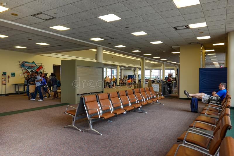 People waiting to board their plane at a small regional airport. Bloomington,IL/USA-8/25/19: People waiting to board their plane at a small regional airport in royalty free stock photography