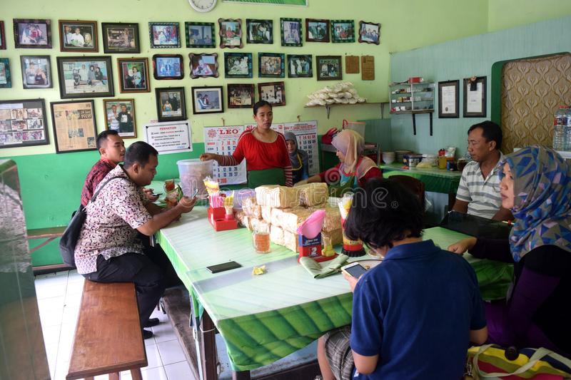 Nasi pecel from Madiun, East Java, Indonesia. People waiting to eat rice pecel in a small restaurant Madiun, East Java, Indonesia on February 12, 2016 royalty free stock images