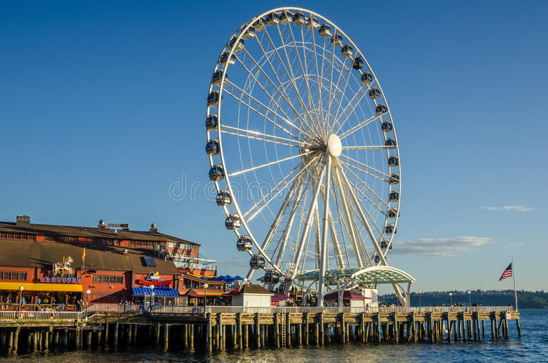 People waiting to ride the Great Wheel at Sunset stock image