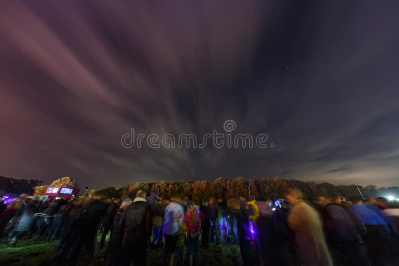 People waiting to see the fireworks display after the traditional event - bon Fire stock photo