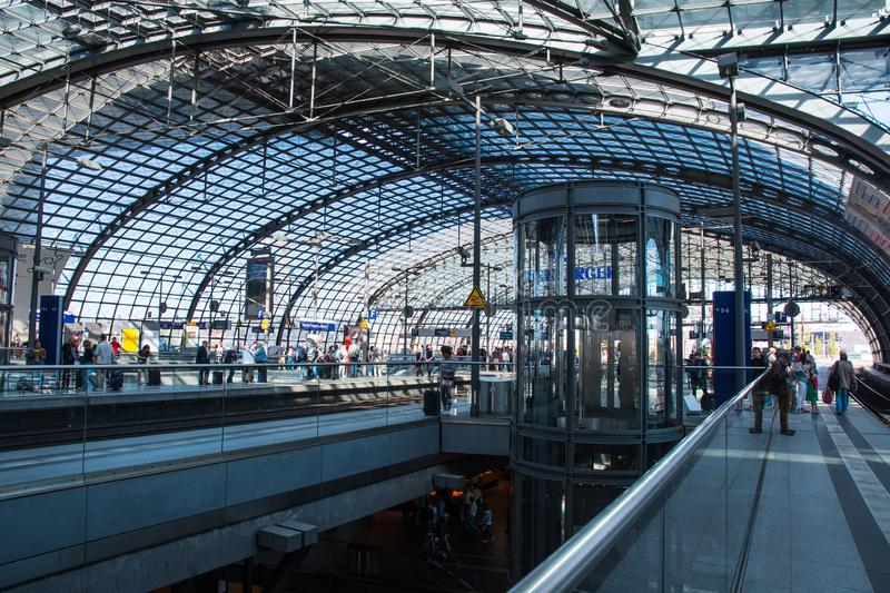 People waiting for the train at Berlin central train station stock photography