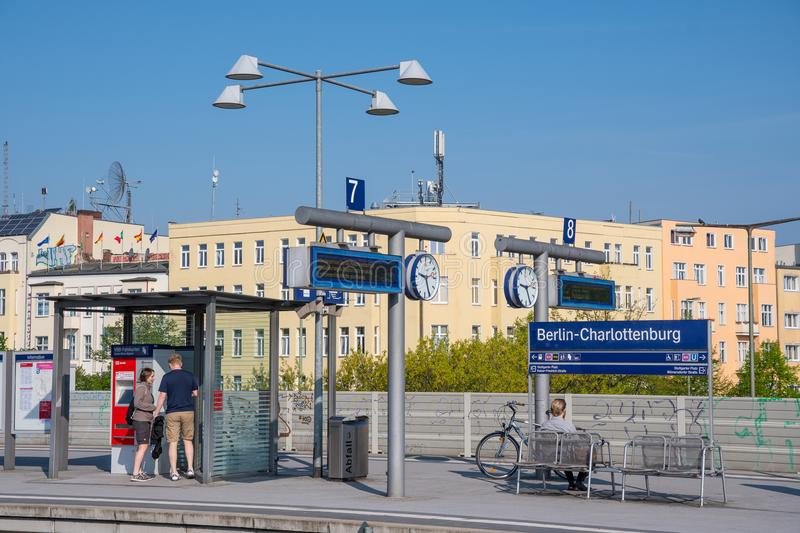 People waiting for the train at Berlin Charlottenburg train station royalty free stock photos