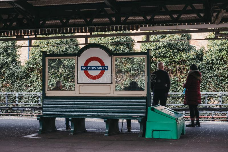 People waiting for the train on the outdoor platform at Golders Green tube station, London, UK royalty free stock photography