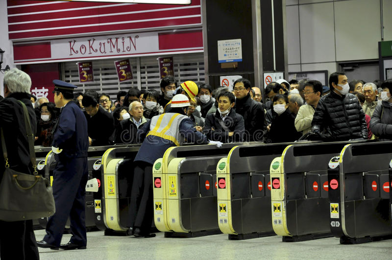People waiting for trains to restart operation. Tokyo, March 12, 2011. All trains and subway trains have stopped because of the ongoing earthquakes and people stock image