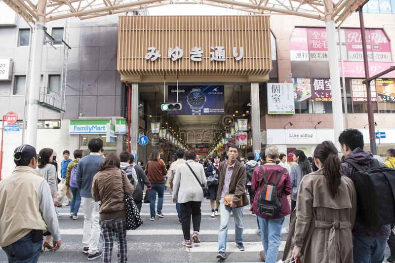 People walk across Miyumi street in Japan. Traveler walk across to Miyuki street while walking to Himeji Castle,Miyuki street is very famous and well know for stock photography