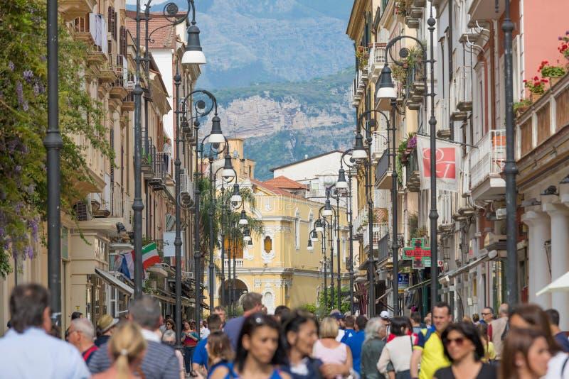 People walk along Corso Italia, main shopping street of Sorrento, Italy. Sorrento, Campania, Italy - April 28, 2018: People walk along Corso Italia, main stock images