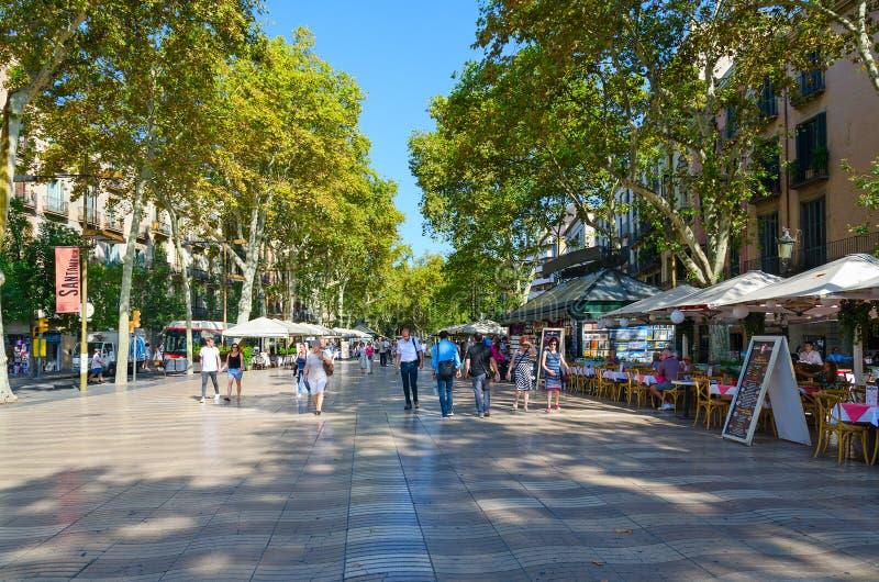 People walk along famous pedestrian street La Rambla, Barcelona, Spain. BARCELONA, SPAIN - SEPTEMBER 13, 2018: Unidentified people walk along famous pedestrian stock photos