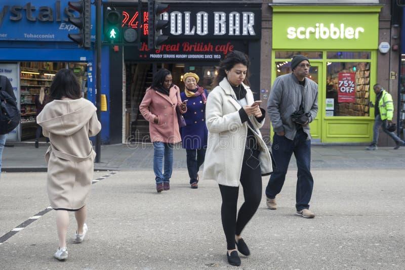 People walk along Liverpool Street. LONDON - FEBRUARY 17, 2019: People walk along Liverpool Street royalty free stock images