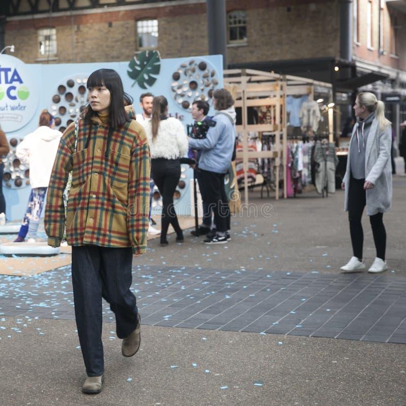 People walk along Liverpool Street. LONDON - FEBRUARY 17, 2019: People walk along Liverpool Street stock photos