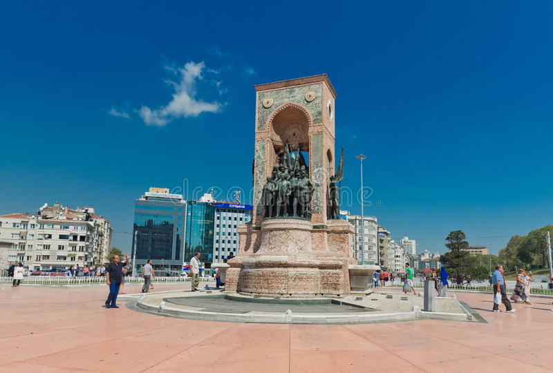 People walk around Republic Monument at Taksim Square in Istanbul. ISTANBUL, TURKEY - AUGUST 27 2013: People walk around Republic Monument at Taksim Square in stock image