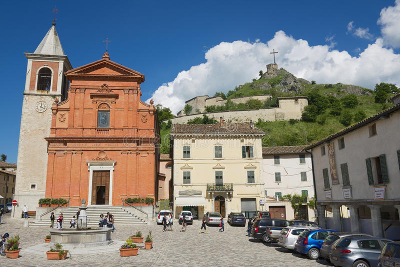 People walk by the central square of the medieval town of Pennabilly, Italy. royalty free stock photos