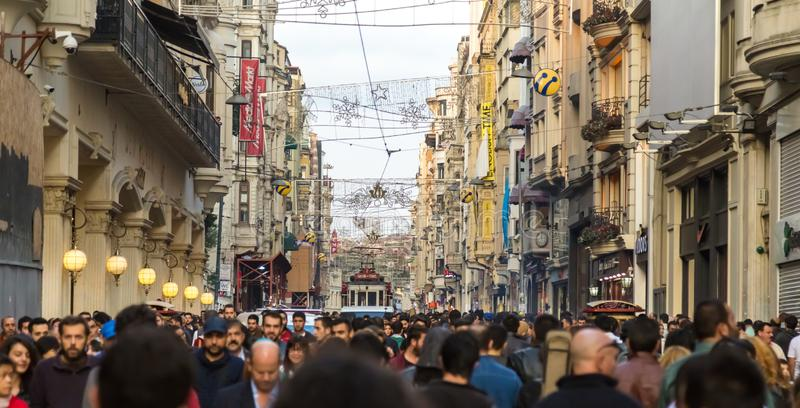 People walk and explore at Istiklal street. Unidentified people walk and explore at Istiklal street,a popular street at Beyoglu district in Istanbul,Turkey.06 stock photography