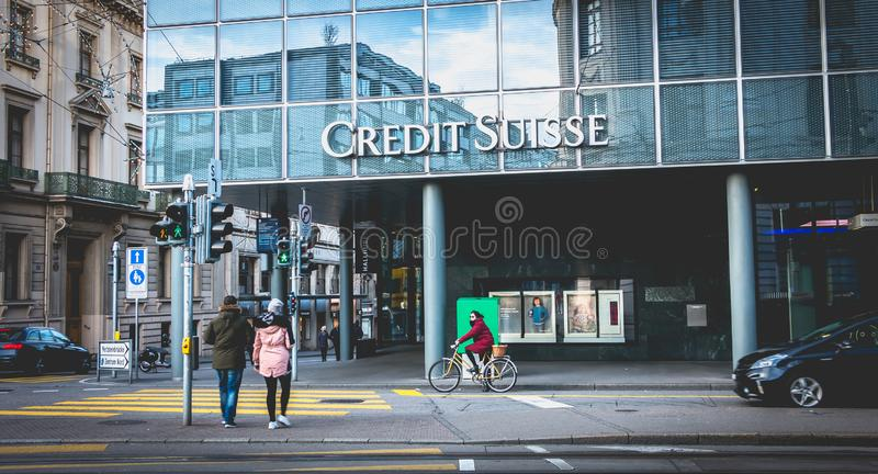 People walk in front of an agency of Credit Suisse business bank royalty free stock photos
