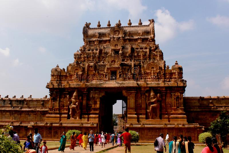 People walk in front of the ancient temple second tower-gopura- of Brihadisvara Temple in Thanjavur, india. Ancient temple-UNESCO World Heritage centre known as stock images