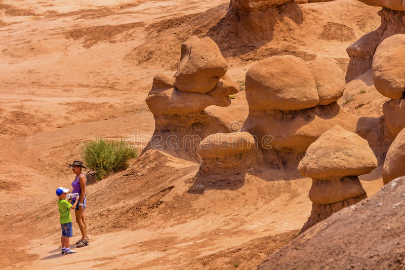 People Walk Among the Goblins Goblin Valley State Park Utah stock photography