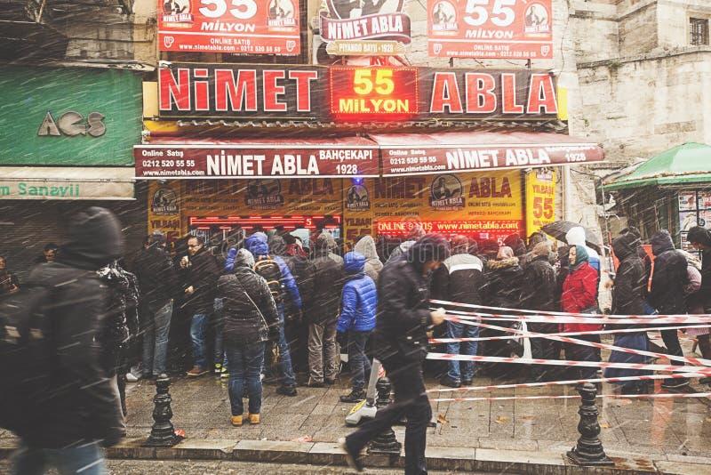 People walk on the Hamidiye Cd Street during the snowy weather in Istanbul. Turkey stock photos