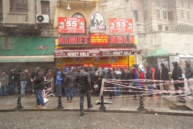 People walk on the Hamidiye Cd Street during the snowy weather in Istanbul. Turkey stock photo