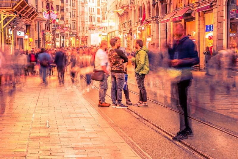 People walk at Istiklal street in Istanbul. Long exposure or slow shutter speed and blurred image:Unidentified people walk at Istiklal street,popular destination stock image