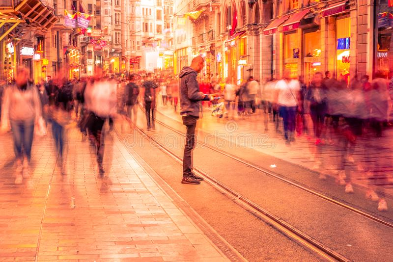 People walk at Istiklal street in Istanbul. Long exposure or slow shutter speed and blurred image:Unidentified people walk at Istiklal street,popular destination stock photo