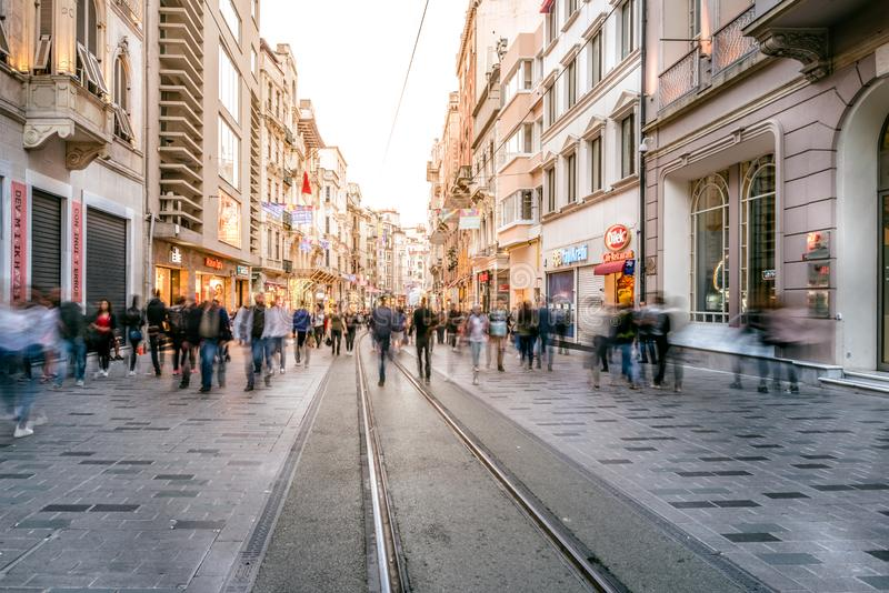 People walk at Istiklal street in Istanbul. Long exposure or slow shutter speed and blurred image:Unidentified people walk at Istiklal street,popular destination stock photos