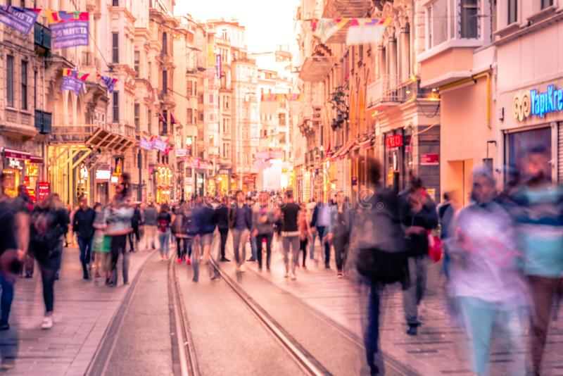 People walk at Istiklal street in Istanbul. Long exposure or slow shutter speed and blurred image:Unidentified people walk at Istiklal street,popular destination royalty free stock images