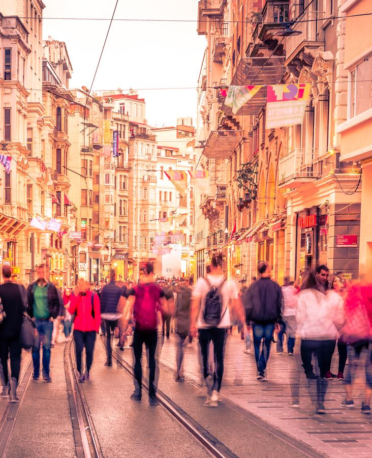 People walk at Istiklal street in Istanbul. Long exposure or slow shutter speed and blurred image:Unidentified people walk at Istiklal street,popular destination stock images