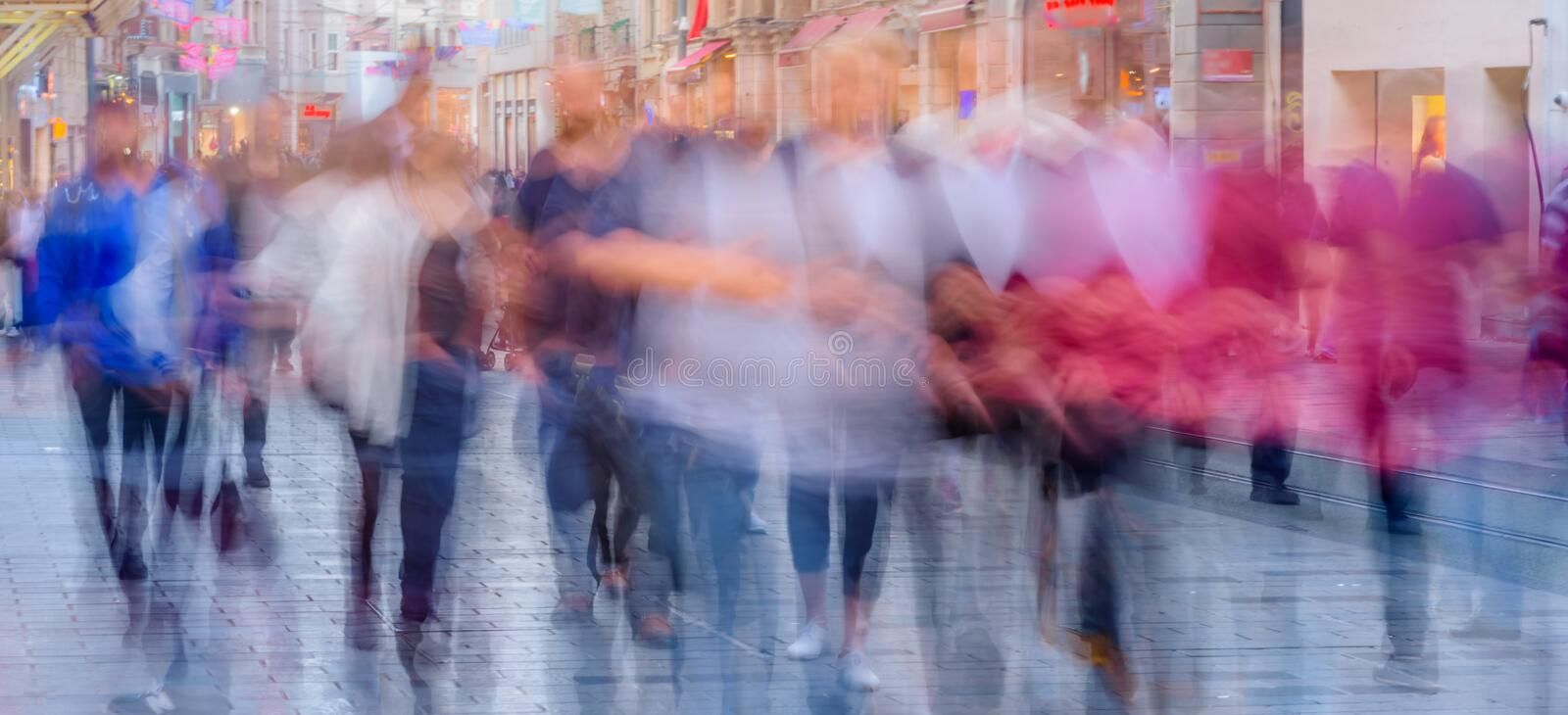 People walk at Istiklal street in Istanbul. Long exposure or slow shutter speed and blurred image:Unidentified people walk at Istiklal street,popular destination stock photography