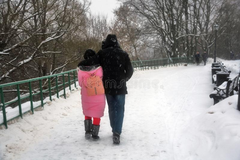 People walk in Kolomenskoye park in Moscow. Color winter photo stock photography
