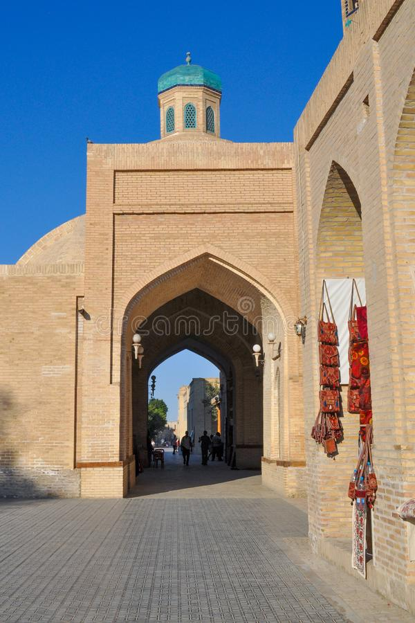 People walk through the market in the center of Bukhara. royalty free stock image
