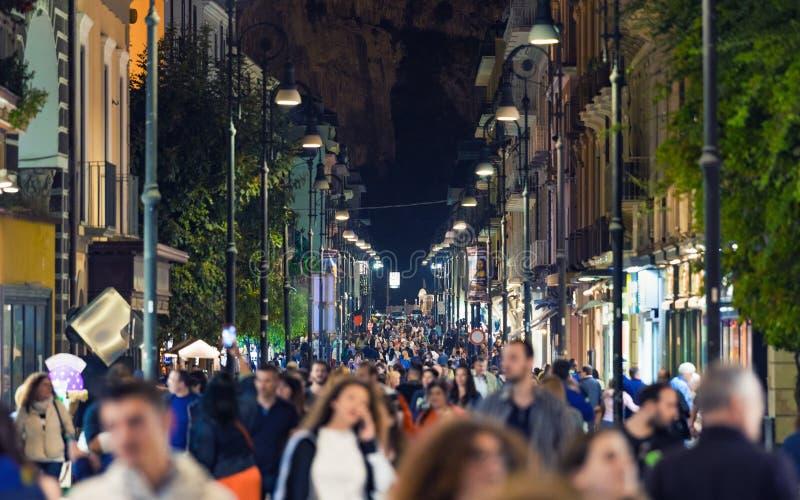People walk at night along Corso Italia main shopping street of Sorrento, Italy. Sorrento, Campania, Italy - May 01, 2018: People walk at night along Corso royalty free stock photo
