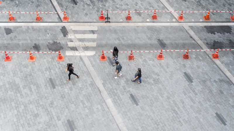 People walk on the pedestrian city street walkway on pavement co. Ncrete with the group of fashion man and woman. Aerial urban city photo stock photography