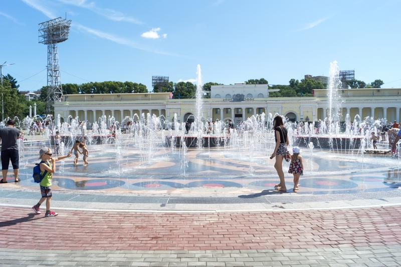 People walk on a pedestrian fountain in the Park in Khabarovsk. stock photography