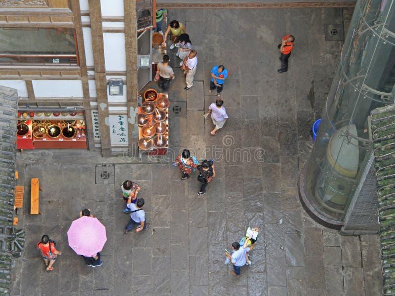 People walk on pedestrian street in Chongqing, view from the top. People walk on pedestrian street in Chongqing, China, view from the top stock photos